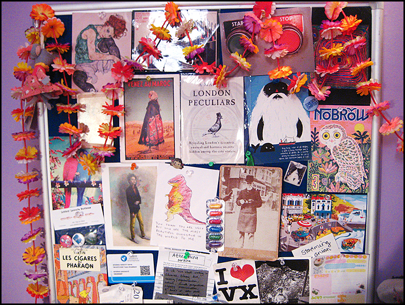 noticeboard with postcards
