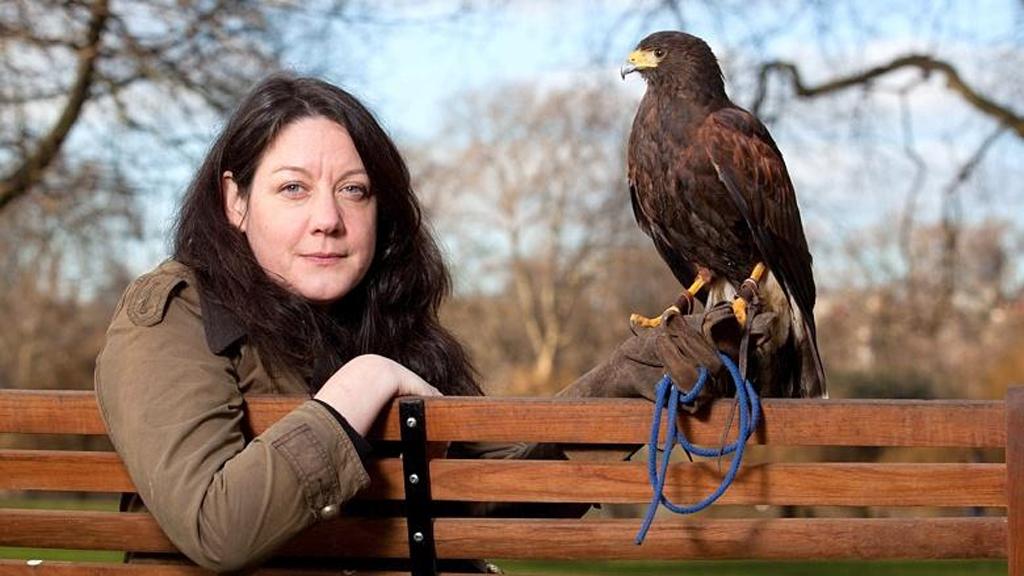 helen macdonald author photo with hawk