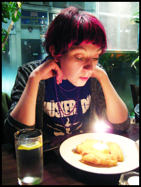 me blowing out a candle